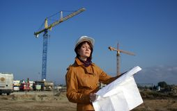 Young architect in front of construction si Royalty Free Stock Photo
