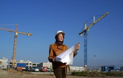 Young architect in front of construction site Stock Image