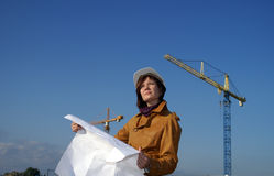 Young architect in front of construction site Stock Photo