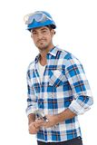 Young architect in hardhat. Young architect standing in hardhat, smiling Stock Photo