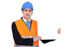 Young architect holding board Royalty Free Stock Photo