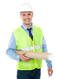 Young architect holding construction map Royalty Free Stock Photos