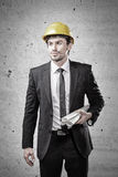 Young architect holding plans Royalty Free Stock Photos