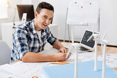 Young architect making changes in blueprint Stock Photo
