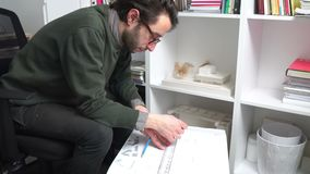 Young architect man notes in his construction plan