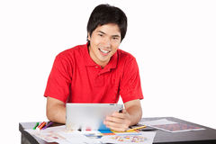 Young Architect Man at Work. Young architect Asian man at work isolated on white background Royalty Free Stock Photo
