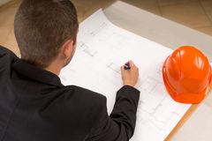 Young architect modifying a building plan Stock Photography