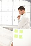 Young architect planning on paper in office Royalty Free Stock Image
