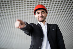 Young architect pointing at you Royalty Free Stock Photos