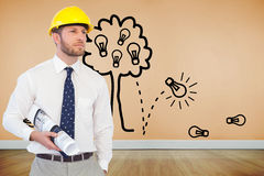 Young architect posing with hard hat and plan Royalty Free Stock Photos