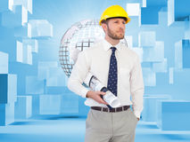 Young architect posing with hard hat and plan Royalty Free Stock Image