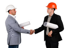 Young architect shaking hands with a businessman Royalty Free Stock Photo
