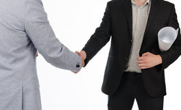 Young architect shaking hands with a businessman Stock Photo
