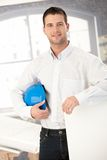 Young architect smiling in office Royalty Free Stock Image