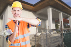 Young architect standing outside on building site Royalty Free Stock Photo
