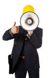Young architect thumb up and megaphone. Young caucasian man architect with helmet and briefcase on shoulder. Megaphone in front face and thumb up. Studio shot Stock Images