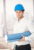 Young architect wearing hardhat Royalty Free Stock Photo
