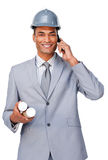 Young architect wearing a hardhat on phone stock images