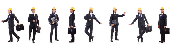 The young architect wearing hardhat on white Stock Photography