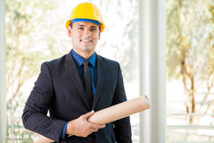 Young architect wearing a helmet Royalty Free Stock Image