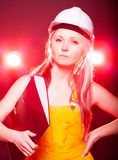 Young architect woman construction worker, blueprints Royalty Free Stock Photography