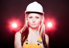 Young architect woman construction worker, glowing lights Stock Images
