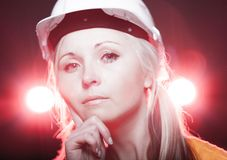 Young architect woman construction worker, glowing lights Royalty Free Stock Photos