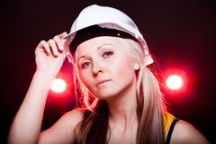 Young architect woman construction worker, glowing lights Stock Image