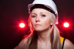 Young architect woman construction worker, glowing lights Stock Photography