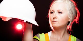 Young architect woman construction worker, safety helmet Stock Photography