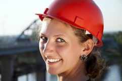 Young architect-woman wearing a protective helmet Stock Images