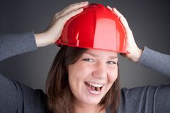 Young architect women wearing red hardhat Stock Photos