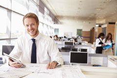 Young architect at work in an office, smiling to camera Stock Photos