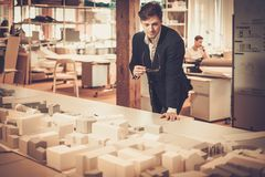 Young architect working in architect  studio. Young architect working in architect studio Royalty Free Stock Photography