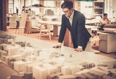 Young architect working in architect  studio. Royalty Free Stock Photos