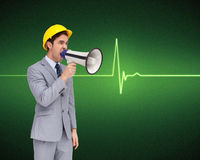 Young architect yelling with a megaphone Royalty Free Stock Photography