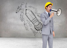 Young architect yelling with a megaphone Stock Photo