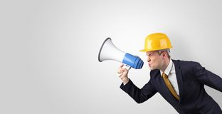 Young architect yelling with megaphone stock photo