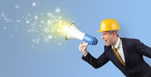 Young architect yelling with megaphone stock photography