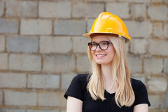Young architect with yellow helmet Royalty Free Stock Images