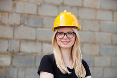 Young architect with yellow helmet Royalty Free Stock Photography