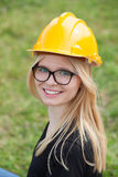 Young architect with yellow helmet Royalty Free Stock Photos