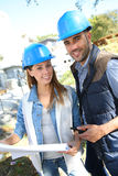 Young architects on construction site Stock Images