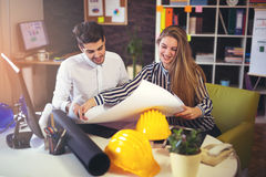 Young architects discussing construction plans in off Royalty Free Stock Photos