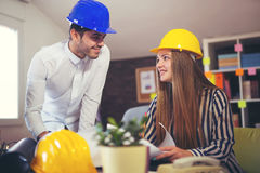 Young architects discussing construction plans in off Stock Image
