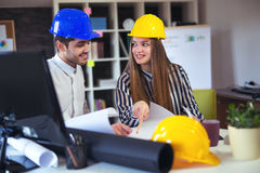 Young architects discussing construction plans in off Stock Images