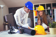 Young architects discussing construction plans in off Royalty Free Stock Image