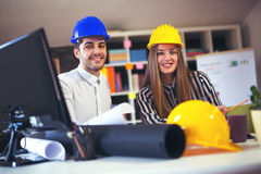 Young architects discussing construction plans in off Royalty Free Stock Images
