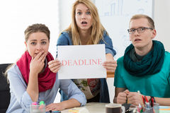 Young architects having very short deadline. For important project Royalty Free Stock Photo