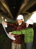 Young architects looking at blueprint. Stock Photo